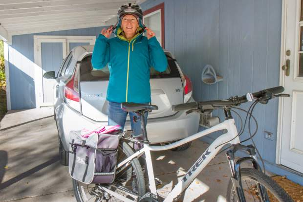 Clare Fuller gets bundled up for her daily bike commute to work from West Glenwood Springs.