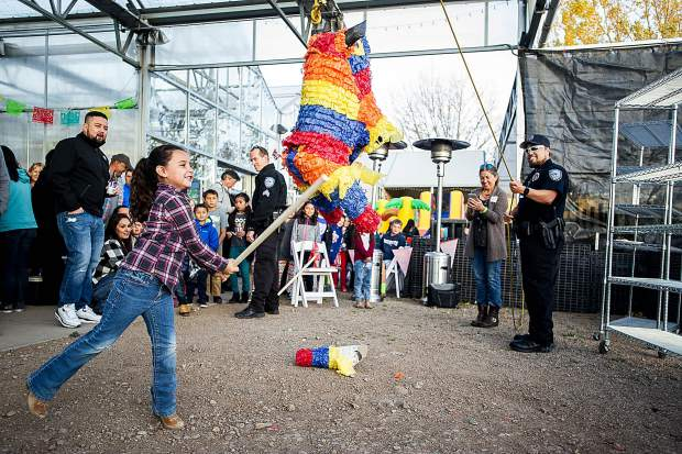 Arianna Leach, 6, hits a pinata at the Fiesta de Tamales in El Jebel Saturday night benefiting English in Action.