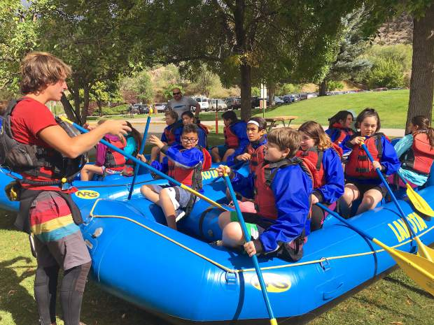 Hayden Knapp of Glenwood Adventure Co. instructs Glenwood Springs Middle School seventh-grade students on proper paddling technique before hitting the water for a recent raft trip. Outdoor programs are a big part of the newly adopted EL Education model at GSMS.