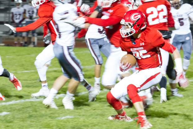 Glenwood Springs Demon Wyatt Ewer looks for an opening in the Palisade Bulldog defense during Friday night's game at Stubler Memorial Field.