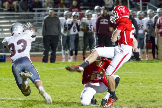 Palisade Bulldog Austin Bernal (33) nearly blocks the kick by Glenwood Springs Demon Tyler Dietrich (20) during Friday night's game at Stubler Memorial Field.