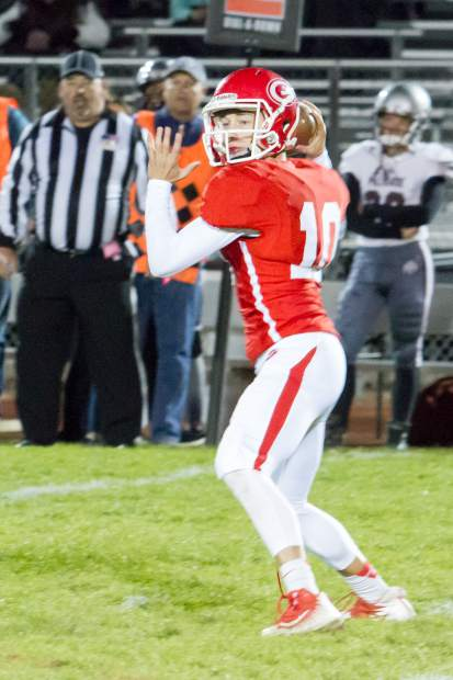 Glenwood Springs Demon quartback AJ Crowley looks for an open player during Friday night's game against the Palisade Bulldogs at Stubler Memorial Field.