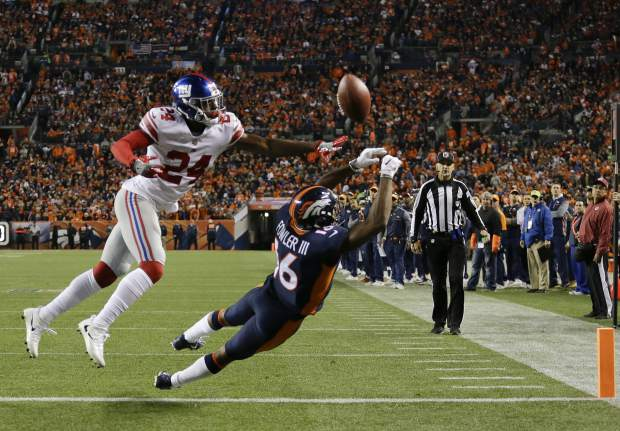 Denver Broncos wide receiver Bennie Fowler, right, can't make the end zone catch as New York Giants cornerback Eli Apple (24) defends during the first half of an NFL football game Sunday, Oct. 15, 2017, in Denver. (AP Photo/Jack Dempsey)