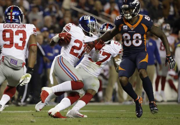 New York Giants strong safety Landon Collins, center, runs after intercepting a pass during the first half of an NFL football game against the Denver Broncos, Sunday, Oct. 15, 2017, in Denver. (AP Photo/Jack Dempsey)