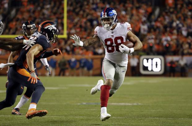 New York Giants tight end Evan Engram (88) runs upfield during the first half of an NFL football game against the Denver Broncos, Sunday, Oct. 15, 2017, in Denver. (AP Photo/Jack Dempsey)