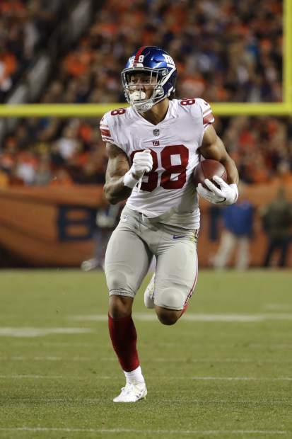 New York Giants tight end Evan Engram (88) runs upfield during the first half of an NFL football game against the Denver Broncos Sunday, Oct. 15, 2017, in Denver. (AP Photo/Jack Dempsey)