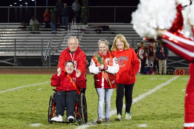 Junior Homecoming royalty Ella Mulhal and James Starbuck walk across the field during the Homecoming halftime show on Friday night's game at Stubler Memorial Field.
