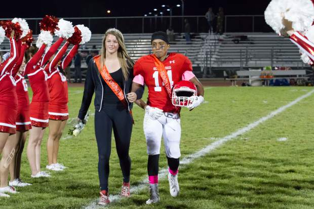 Senior Homecoming royalty Luis Mariano and Devan McSwain walk across the field during the halftime show on Friday night's game at Stubler Memorial Field.