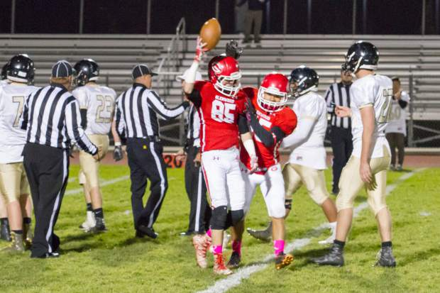 Glenwood Springs Demon Wyatt Ewer (85) walks away with the ball after a fumble recovery during Friday night's game against the Battle Mountain Huskies at Stubler Memorial Field.
