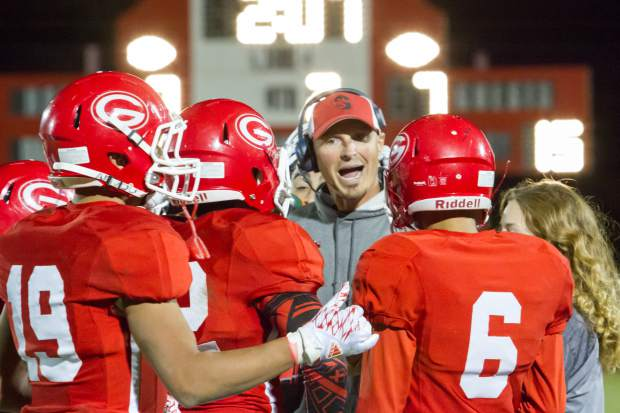 Glenwood Springs High School Asst. Coach Neil Goluba speaks with the players during a time-out at Friday night's game against the Battle Mountain Huskies.