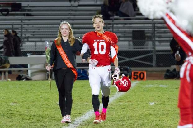Senior Homecoming royalty AJ Crowley and Saylor Warren walk across the field during the Homecoming halftime show during Friday night's game at Stubler Memorial Field.