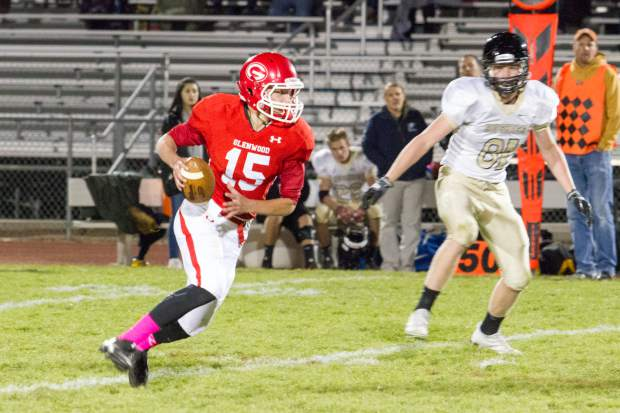 Glenwood Springs Demon Brady Steen (15) looks for an open player during Friday night's game against the Battle Mountain Huskies at Stubler Memorial Field.