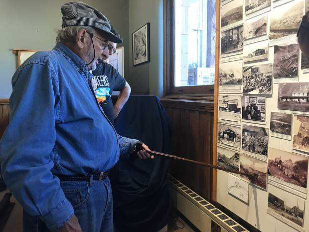 Arthur Seagul describes area railroad history to visitors during a recent tour of the Glenwood Railroad Museum. Seagul is one of several volunteers at the downtown museum.