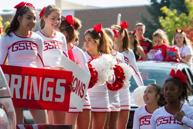 The GSHS cheerleaders make their way down the 2017 Glenwood Springs High School homecoming parade on Friday afternoon.