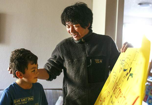 Shuei Kato, right, expresses thanks to his son, Reo, while taking a first look at the