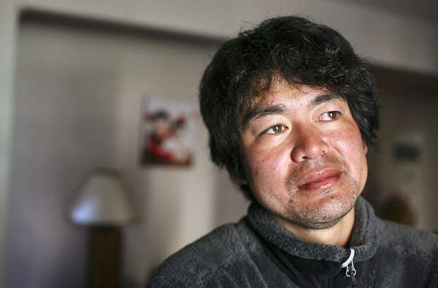 Shuei Kato, looks out the window from his home in Wildnernest near Silverthorne on Wednesday Oct. 13, after surviving three subzero nights in the backcountry after getting lost on his way down from Colorado 14,000-foot peak Missouri Mountain this past Saturday.