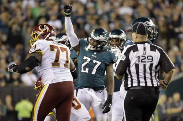 Philadelphia Eagles strong safety Malcolm Jenkins (27) gestures after sacking Washington Redskins quarterback Kirk Cousins (8) during the second half of an NFL football game, Monday, Oct. 23, 2017, in Philadelphia. (AP Photo/Michael Perez)