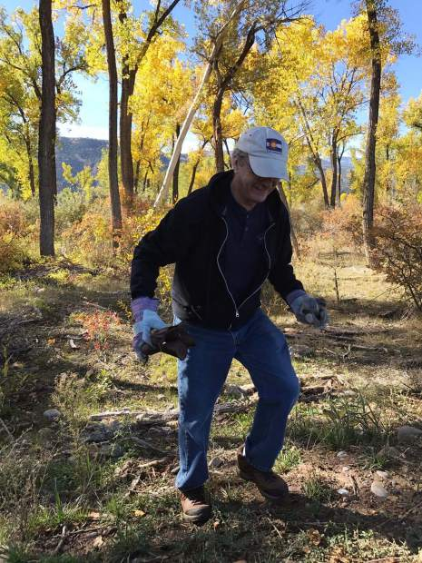 Bob Haynes picked up trash handfuls at a time for the clean up.