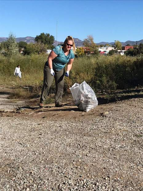 Stacey Hardene and other volunteers picked up trash around Rifle new boat ramp on Saturday for the River Clean Up.