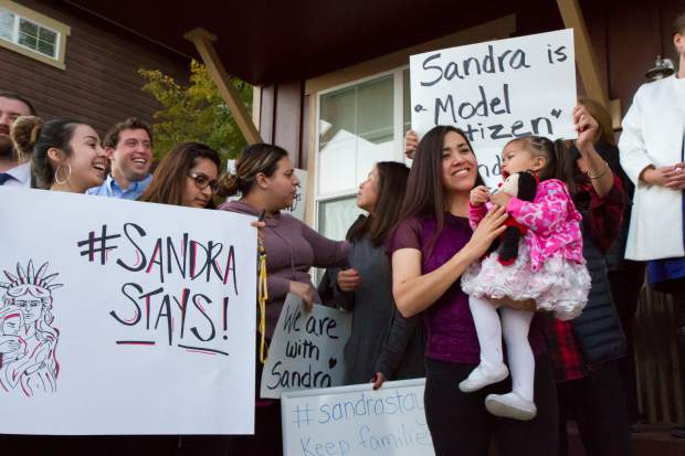 Sandra Lopez and her two-year-old daughter Areli stand with her supports during the press conference in Carbondale on Tuesday evening.