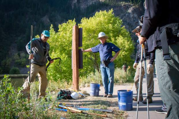 A Volunteers for Outdoor Colorado crew leaders demonstrates proper use and handling of equipment before heading up the Hanging Lake trail Saturday morning.