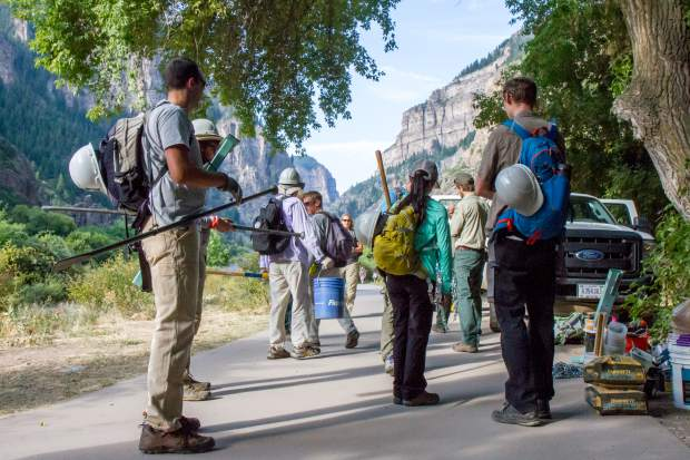 Trail work volunteers gather up equipment at the Hanging Lake trailhead.