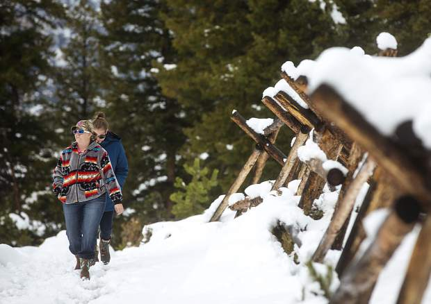 Out-of-state hikers trudge through the newly fallen snow on Sapphire Point trail Monday, Oct. 2.