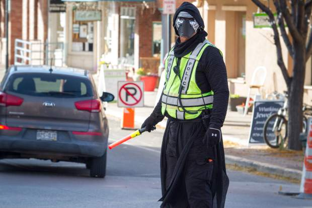 Glenwood Springs Police Chief Kylo Ren (Terry Wilson) directs traffic at Eight Street and Grand Avenue during the early evening rush hour on Tuesday.
