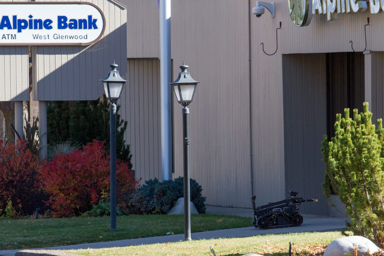 A robot is sent into the Alpine Bank in West Glenwood after a suspicious package was left inside on Thursday morning.