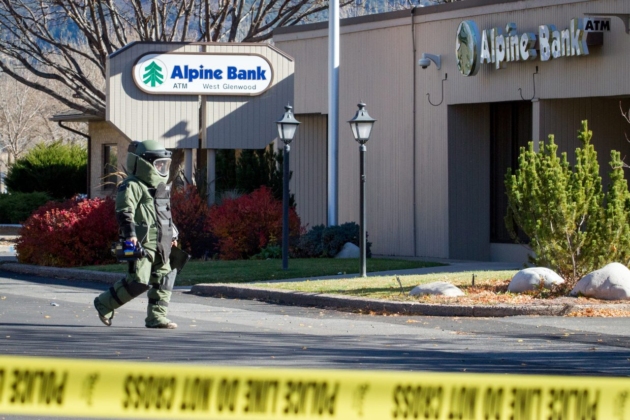 A member of the Grand Junction Police Department Bomb Squad heads over to the Alpine Bank in West Glenwood after a suspicious package was left inside on Thursday morning.