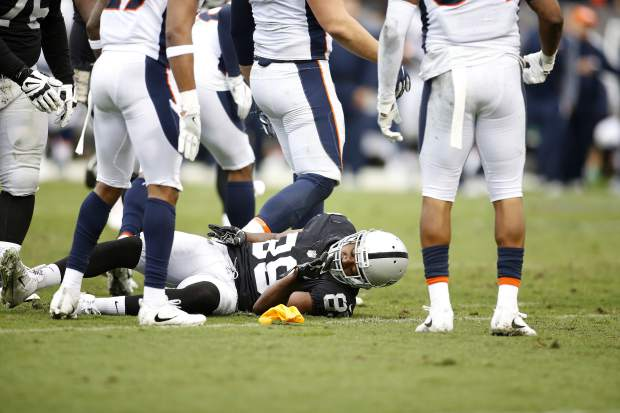 Oakland Raiders wide receiver Amari Cooper (89) remains on the ground after being hit against the Denver Broncos during the first half of an NFL football game in Oakland, Calif., Sunday, Nov. 26, 2017. (AP Photo/D. Ross Cameron)
