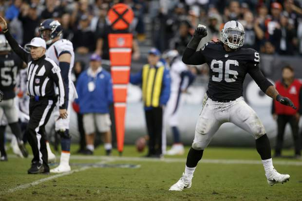 Oakland Raiders defensive end Denico Autry (96) celebrates after sacking Denver Broncos quarterback Paxton Lynch during the second half of an NFL football game in Oakland, Calif., Sunday, Nov. 26, 2017. (AP Photo/D. Ross Cameron)