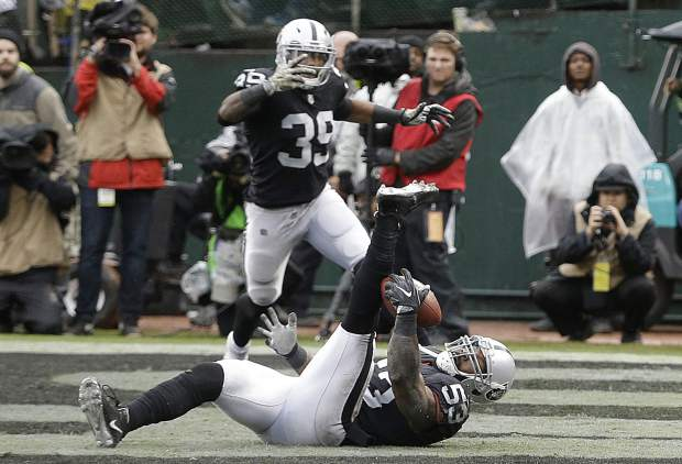 Oakland Raiders linebacker NaVorro Bowman (53) intercepts a pass in the end zone during the first half of an NFL football game against the Denver Broncos in Oakland, Calif., Sunday, Nov. 26, 2017. (AP Photo/Ben Margot)