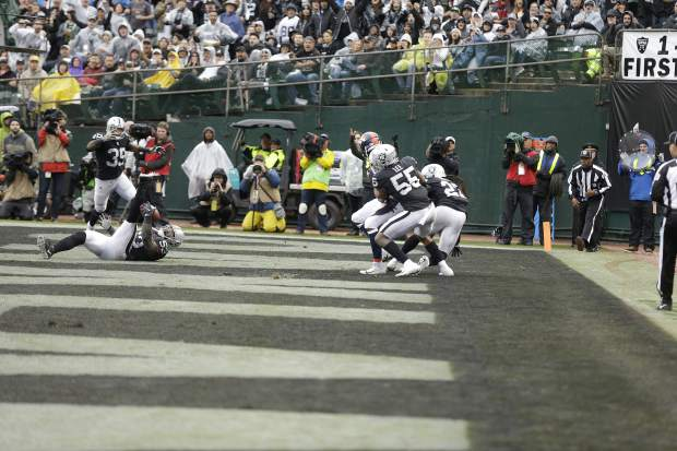 Oakland Raiders linebacker NaVorro Bowman (53) intercepts a pass in the end zone against the Denver Broncos during the first half of an NFL football game in Oakland, Calif., Sunday, Nov. 26, 2017. (AP Photo/Ben Margot)