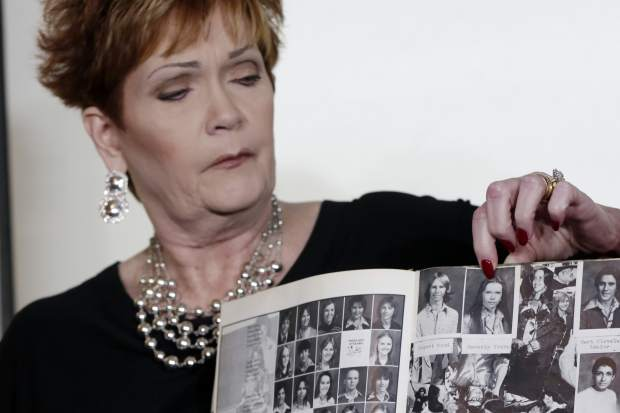 Beverly Young Nelson, the latest accuser of Alabama Republican Roy Moore, points to her photo in her high school yearbook during a news conference in New York, Monday, Nov. 13, 2017. Nelson says Moore assaulted her when she was 16 and he offered her a ride home from a restaurant where she worked. (AP Photo/Richard Drew)