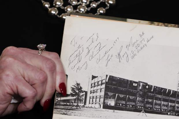 Beverly Young Nelson the latest accuser of Alabama Republican Roy Moore, shows her high school yearbook signed by Moore, at a news conference, in New York, Monday, Nov. 13, 2017.Nelson says Moore assaulted her when she was 16 and he offered her a ride home from a restaurant where she worked. Moore says the latest allegations against him are a