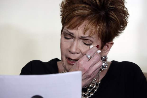 Beverly Young Nelson, the latest accuser of Alabama Republican Roy Moore, reads her statement at a news conference, in New York, Monday, Nov. 13, 2017. Nelson says Moore assaulted her when she was 16 and he offered her a ride home from a restaurant where she worked. Moore says the latest allegations against him are a