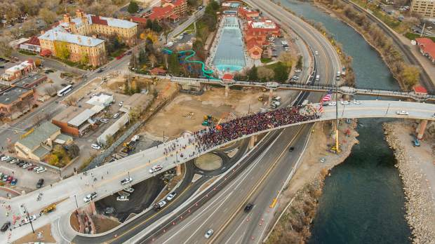 An estimated 3,000 people came together to celebrate the ribbon cutting and official opening of the new Grand Avenue bridge on Monday evening.