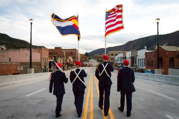The Glenwood Springs High School Air Force JROTC led the crowd of more than 3,000 across the new Grand Avenue bridge after the official ribbon cutting ceremony on Monday evening.
