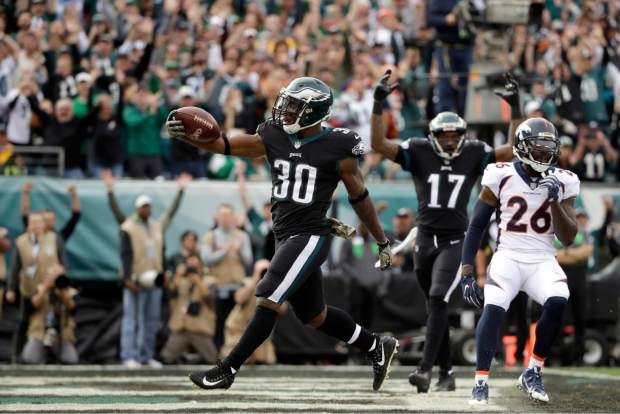 Philadelphia Eagles' Corey Clement celebrates after scoring a touchdown during the first half of an NFL football game against the Denver Broncos, Sunday, Nov. 5, 2017, in Philadelphia. (AP Photo/Matt Rourke)