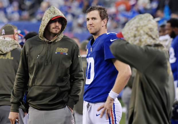 New York Giants quarterback Eli Manning (10) watch his team play during the second half of an NFL football game against the Los Angeles Rams, Sunday, Nov. 5, 2017, in East Rutherford, N.J. (AP Photo/Bill Kostroun)
