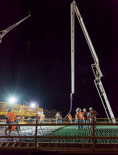Grand Avenue bridge crews work on a nighttime concrete pour.