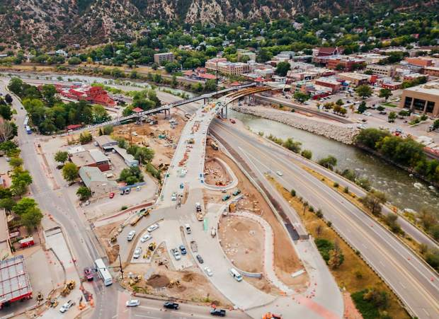 The new Grand Avenue bridge and roundabout take shape in September.