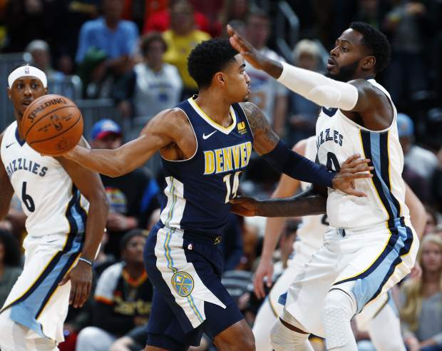 Denver Nuggets guard Gary Harris, left, looks to pass the ball as Memphis Grizzlies forward JaMychal Green defends in the first half of an NBA basketball game Friday, Nov. 24, 2017, in Denver. (AP Photo/David Zalubowski)