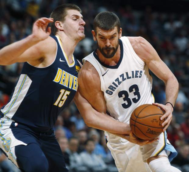 Memphis Grizzlies center Marc Gasol, right, of Spain, drives the lane past Denver Nuggets center Nikola Jokic, of Serbia, in the first half of an NBA basketball game Friday, Nov. 24, 2017, in Denver. (AP Photo/David Zalubowski)