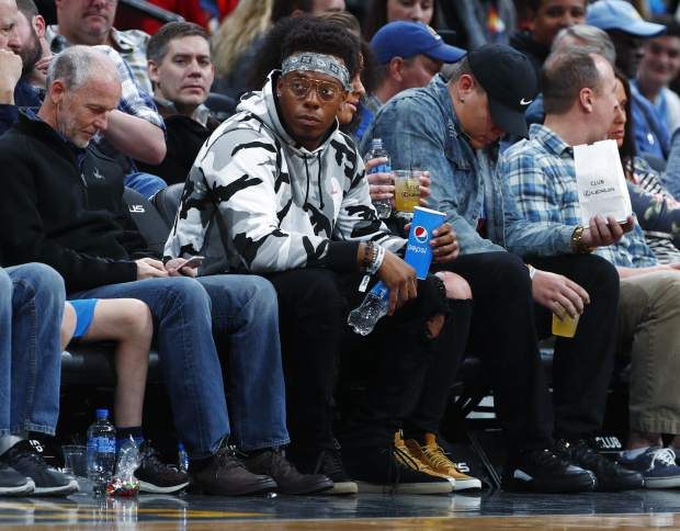 Denver Broncos linebacker Brandon Marshall takes a court side seat to watch the Denver Nuggets host the Memphis Grizzlies in the first half of an NBA basketball game Friday, Nov. 24, 2017, in Denver. (AP Photo/David Zalubowski)