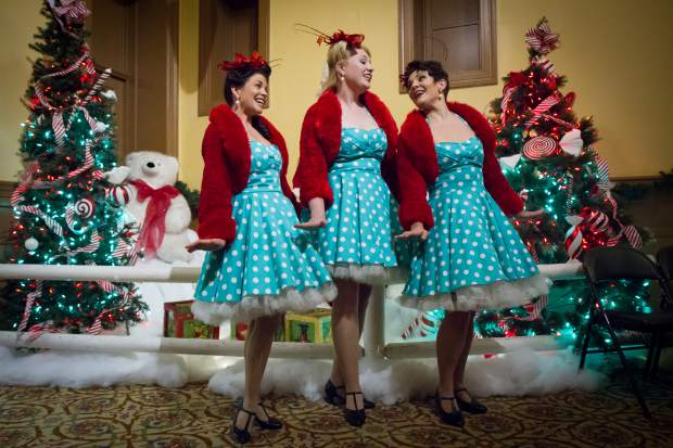 The Denver Dolls sing carols for the crowds at the 28th annual Festival of Lights at the Hotel Colorado.