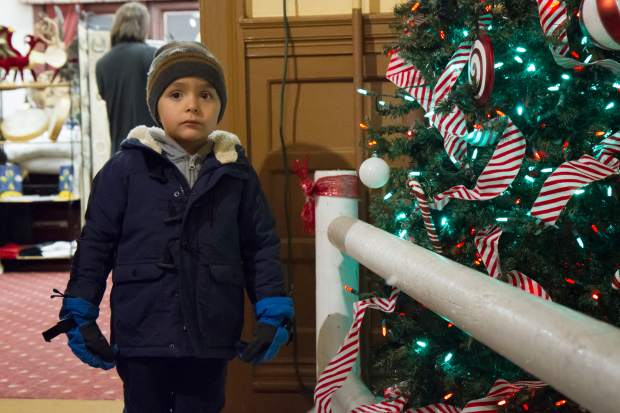 Three-year-old Jake Torinus checks out the displays with his family at the 28th annual Festival of Lights at the Hotel Colorado.