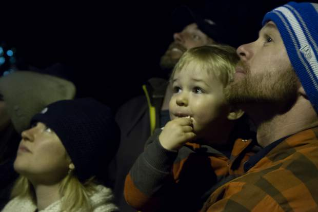 One-year-old Liam Toews and his dad Wesley watch the fireworks outside the Hotel Colorado during the 28th annual Festival of Lights.