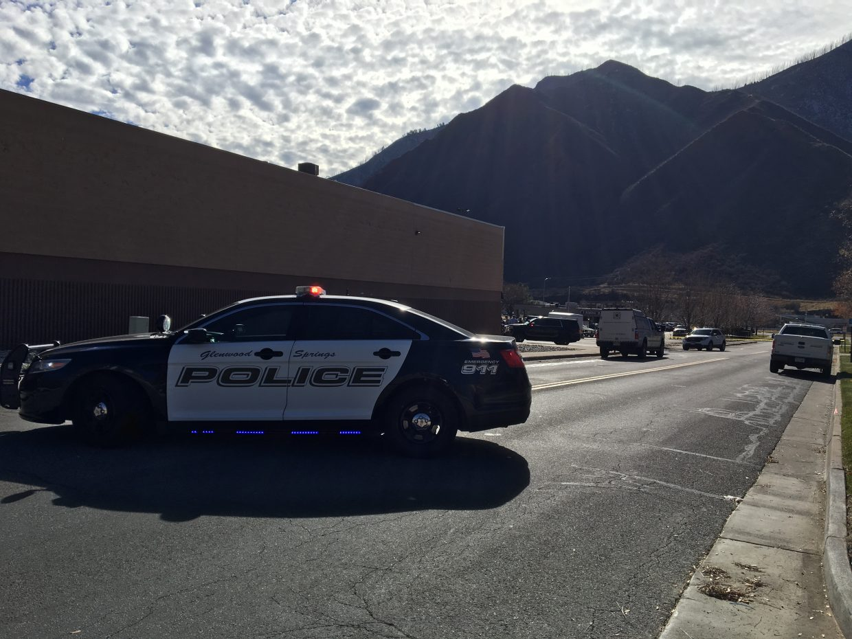 Police on scene on Storm King Road near Glenwood Springs Ford, where the suspect reportedly fled towards.